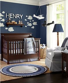 Clouds in the sky - dark blue/navy walls with puffy painted white clouds.