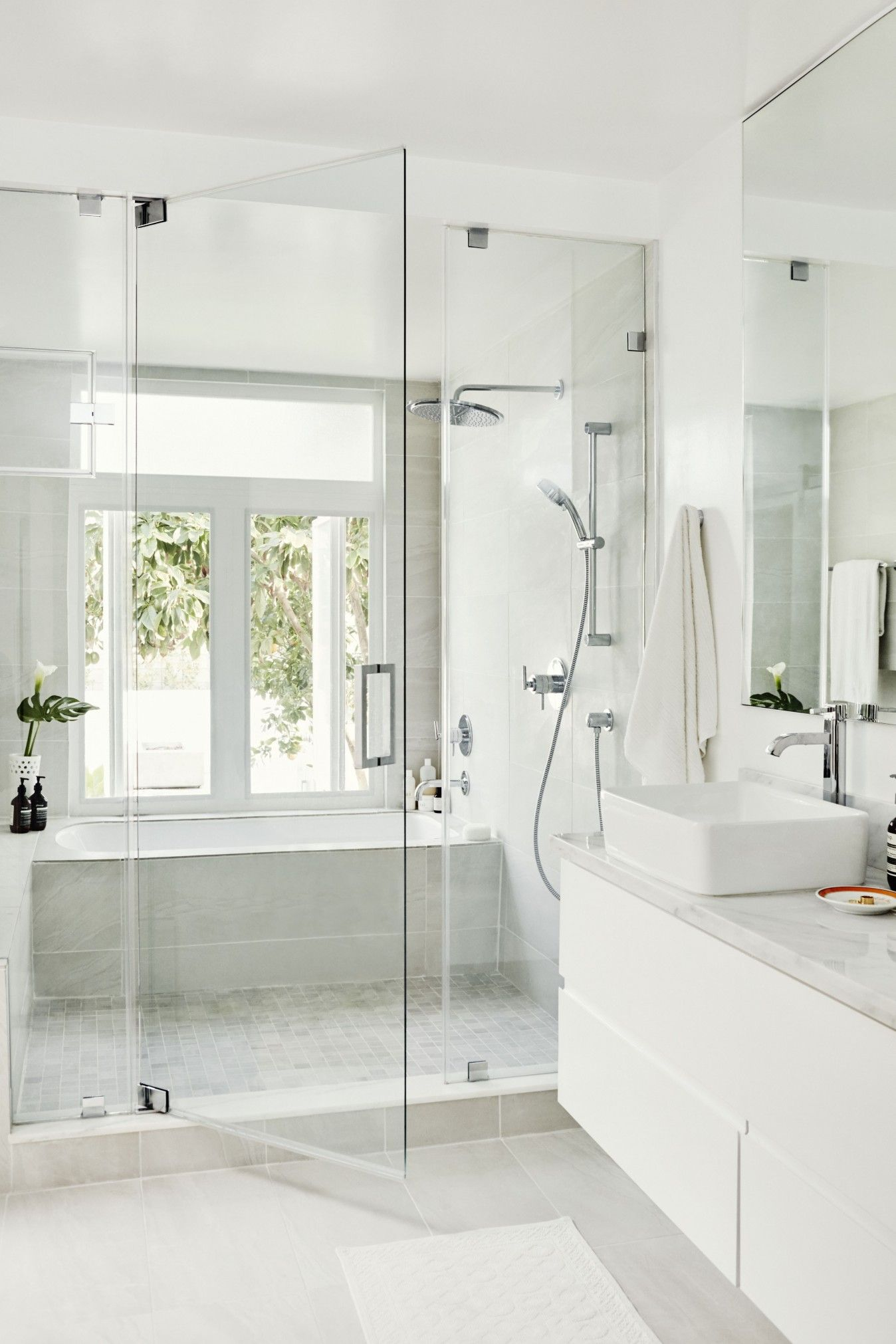 bathroom inspiration // glass shower doors and oversized grey tiles ...
