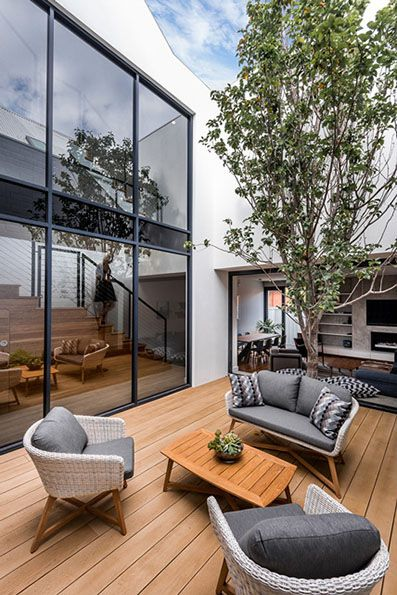 This Home Has A Central Double Height Void With A Courtyard That Creates A