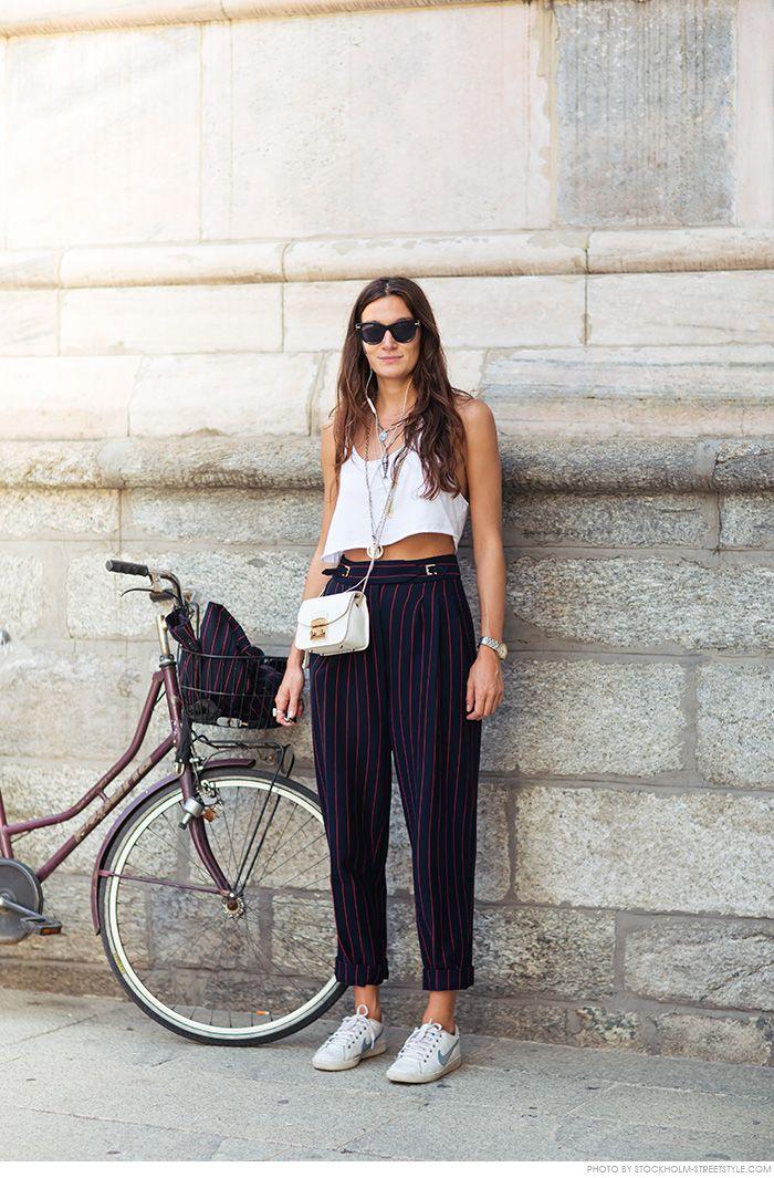white top, blue pants, white sneakers. Street summer women