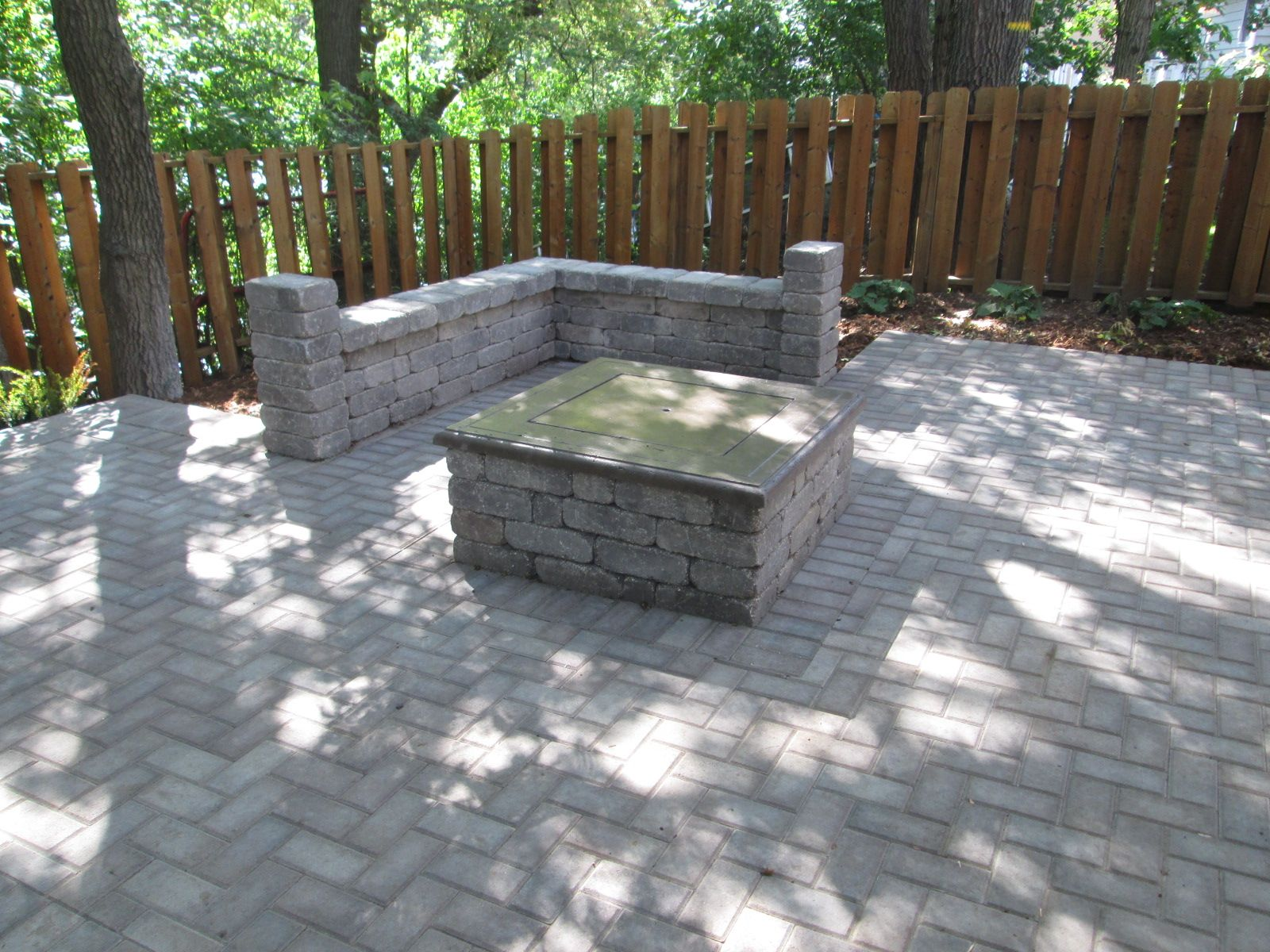 A Paver Sitting Wall And Fire Pit Design Installation By Barrett Lawn Care The Patio Uses Anchor Kingston Pavers Ironstone Color
