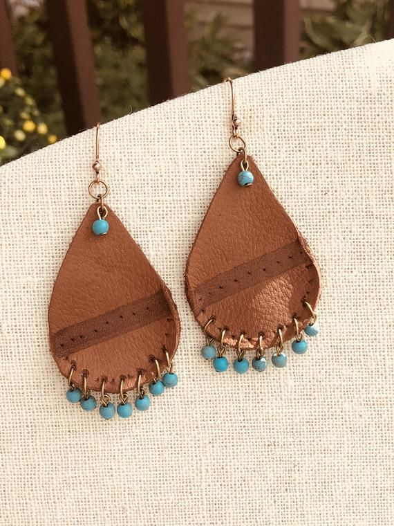 Photo of Items similar to Brown Leather Teardrop Earrings, Leather Earrings with Turquoise Beads on Vintage Brass Ear Wires, Handmade Earrings by Leah Mead on Etsy