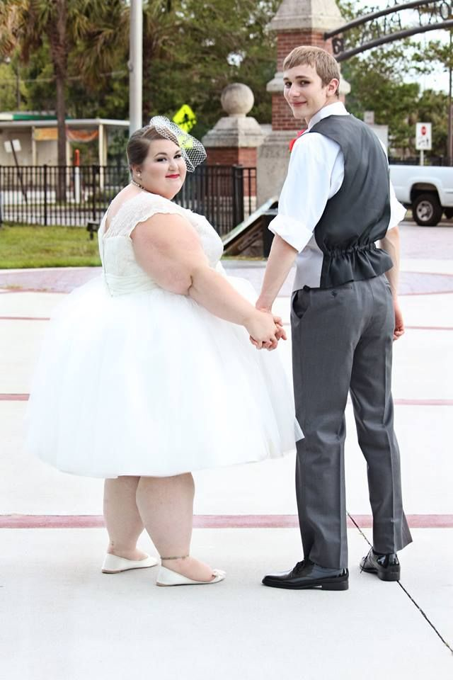 Beautiful bride and groom holding hands fat bbw for Wedding dresses for thick brides