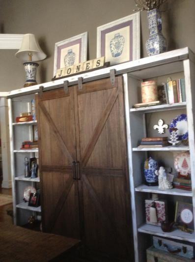 Wood Farmhouse Barn Door Bookcase | World Market. option to paint side sleeves white & Wood Farmhouse Barn Door Bookcase: Brown by World Market | Barn ...