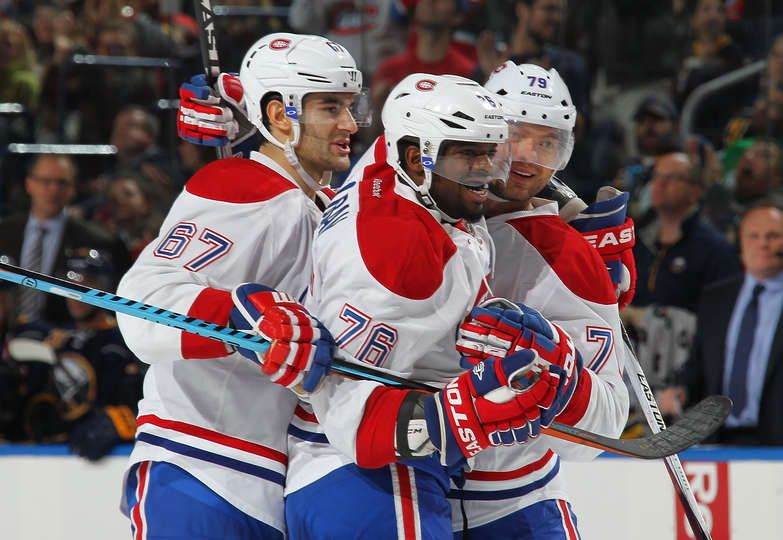 10.23.15 - Habs vs Sabres - Andrei Markov #79 of the Montreal Canadiens celebrates his second period goal against the Buffalo Sabres with teammates Max Pacioretty #67 and P.K. Subban #76 during an NHL game at the First Niagara Center in Buffalo, New York. (Photo by Bill Wippert/NHLI via Getty Images)
