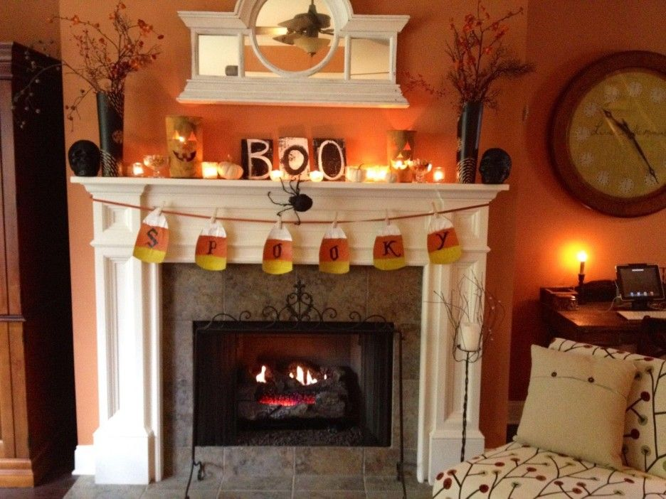 Interior. White Fireplace With Double Black Pots And Some Small Candles  Connected By Orange Wall