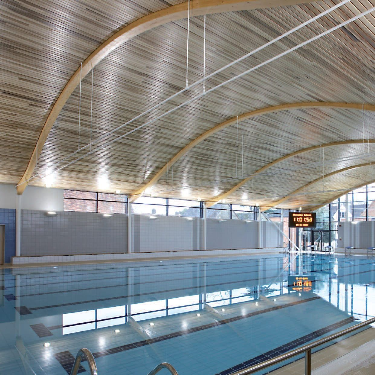 Wooden suspended ceiling panel acoustic for swimming pools linear open hunter douglas for Indoor swimming pool ceiling materials