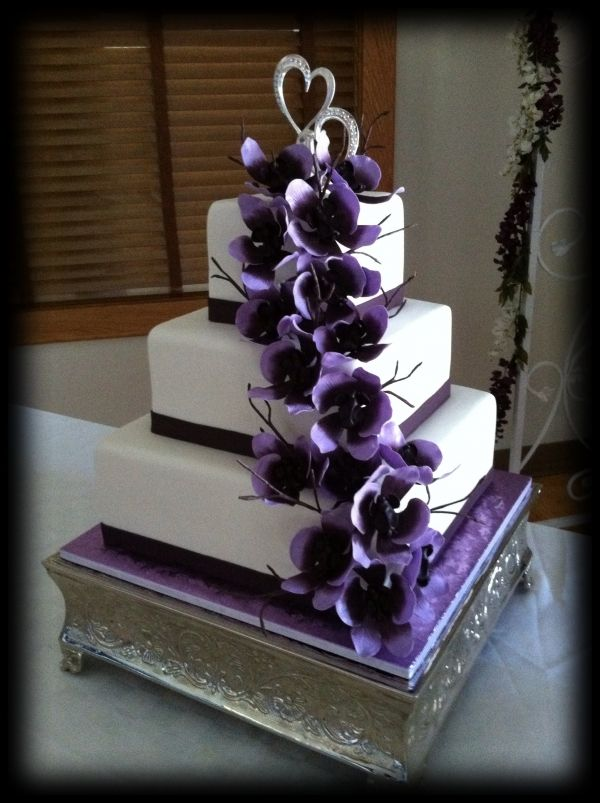 Love this look white cake with cascading purple flowers wedding love this look white cake with cascading purple flowers mightylinksfo