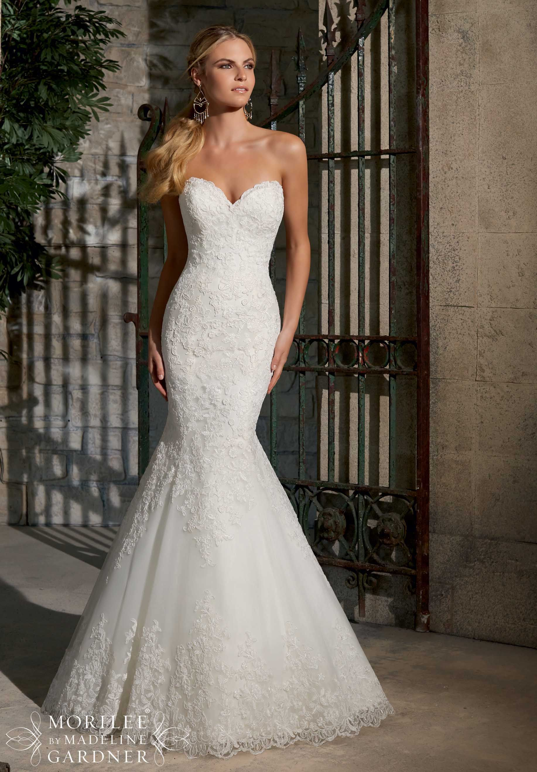 Trending Wedding Gowns by Morilee featuring Elegant Alencon Lace on Net with Wide Hemline Available in