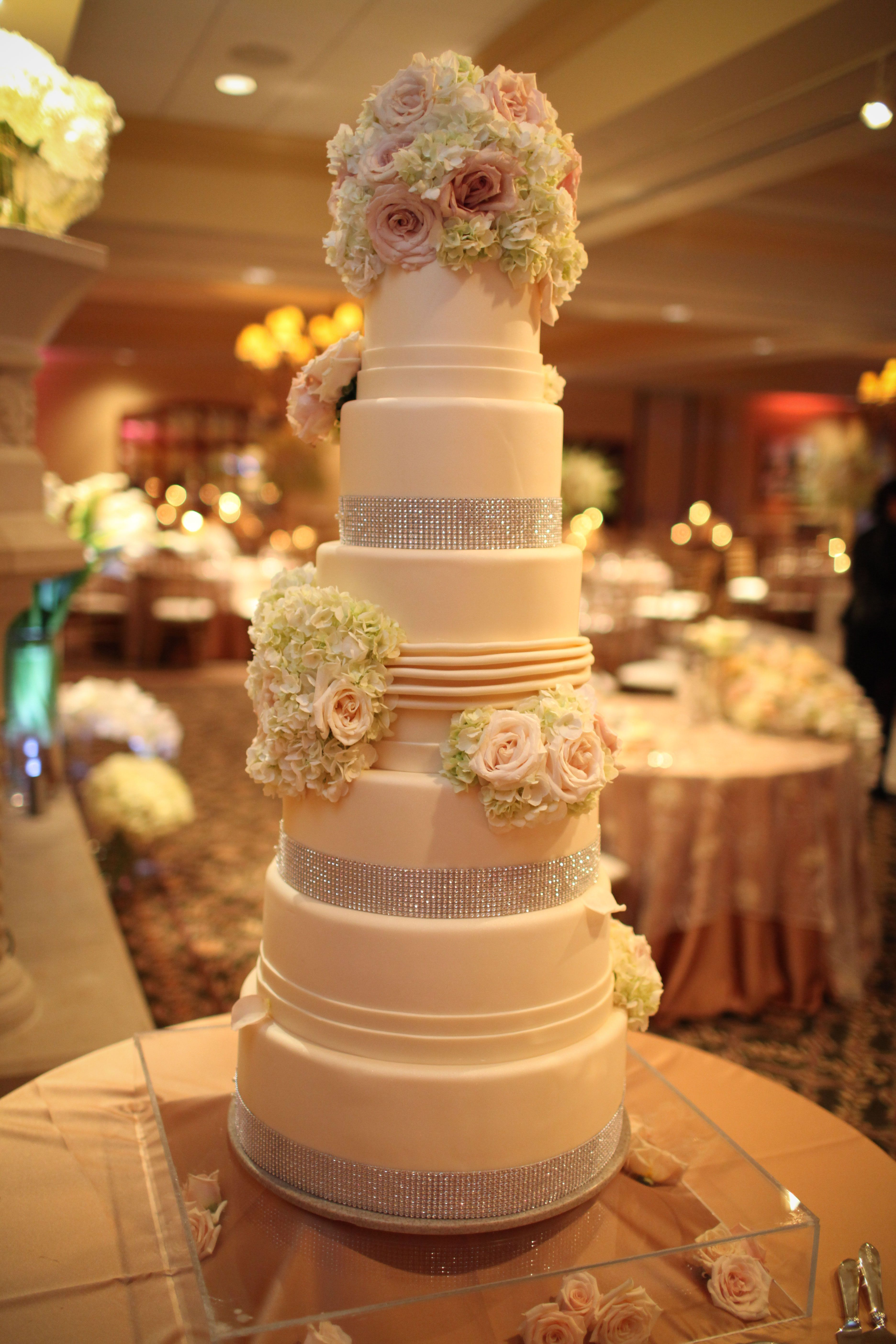 Turning Stone Wedding Cake Six Tiers Stacked And Finished In Ivory Fondant Topped With