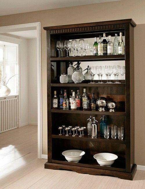 das bar regal im kolonialstil bietet unmengen an platz f r gl ser und sonstige baraccessoires. Black Bedroom Furniture Sets. Home Design Ideas