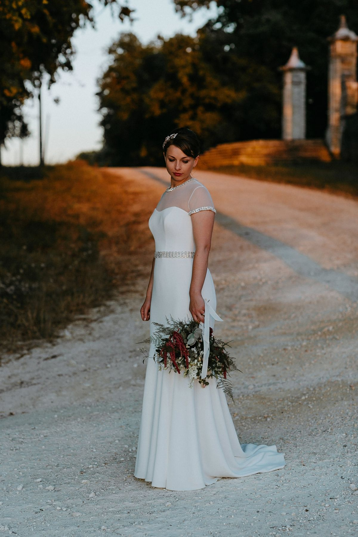 A chic suzanne neville gown for a classic french château wedding