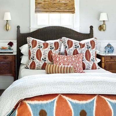 Bedside sconces (like these in antique brass) save space in small bedrooms. The bed is by Mainly Baskets.   Coastalliving.com