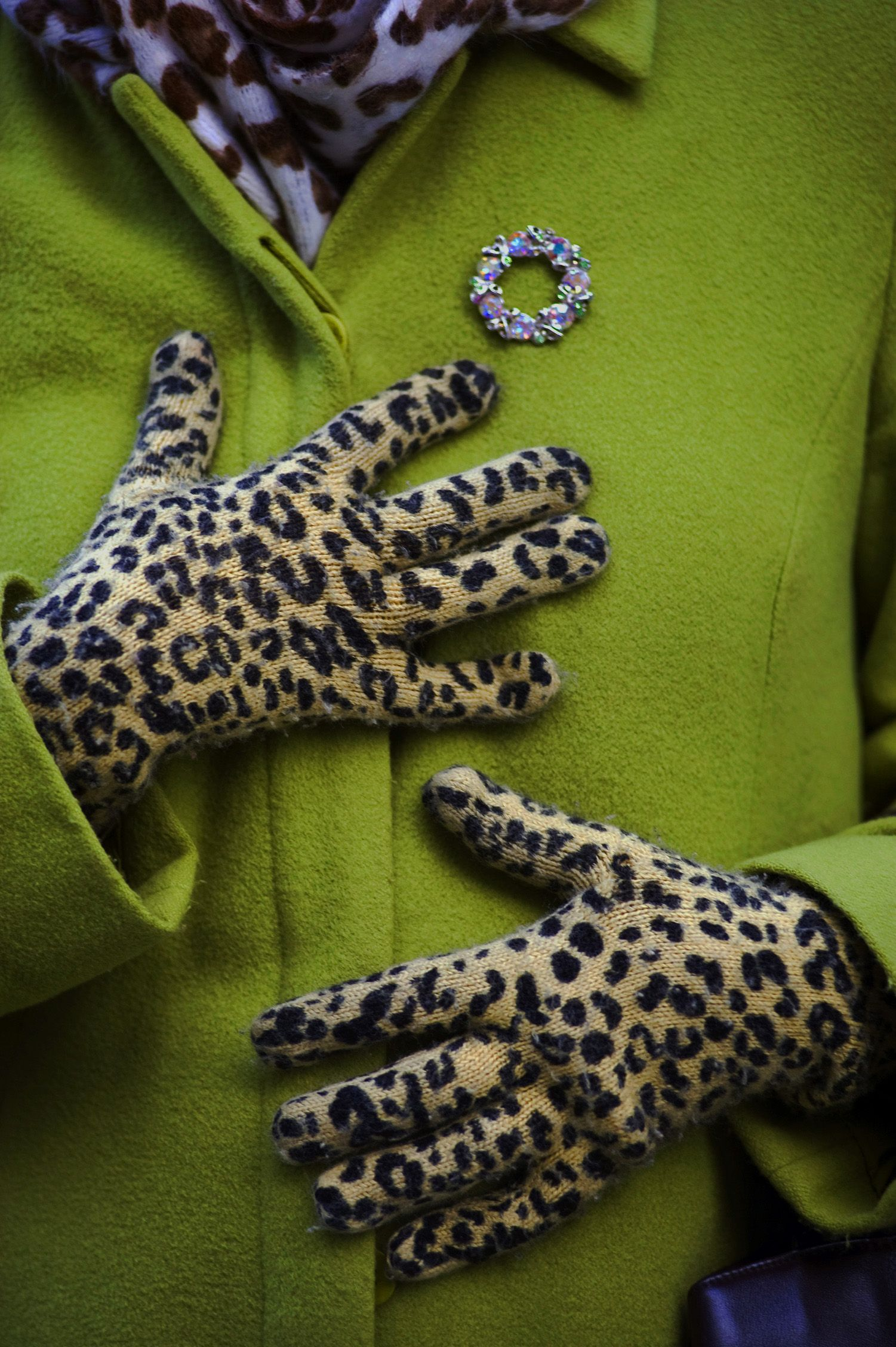 green coat and animal print gloves