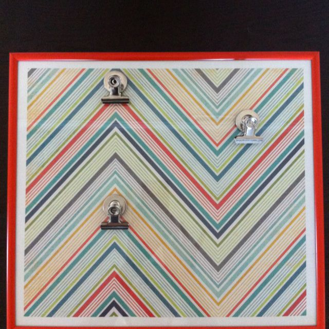 chevron picture frame: goodwill frame ($2.99), scrapbook paper under glass, hot glue clips to display & change photos w/ease