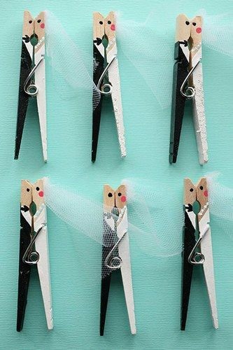 Hand painted bride and groom kissing clothespins make a super-cute wedding favour. Find more wedding favour ideas here http://raspberrywedding.com/category/raspberry-wedding/decoration/stationeryandfavours/