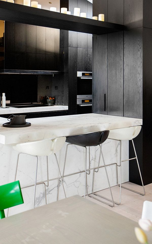 black wood cabinets + white marble island + bar stools