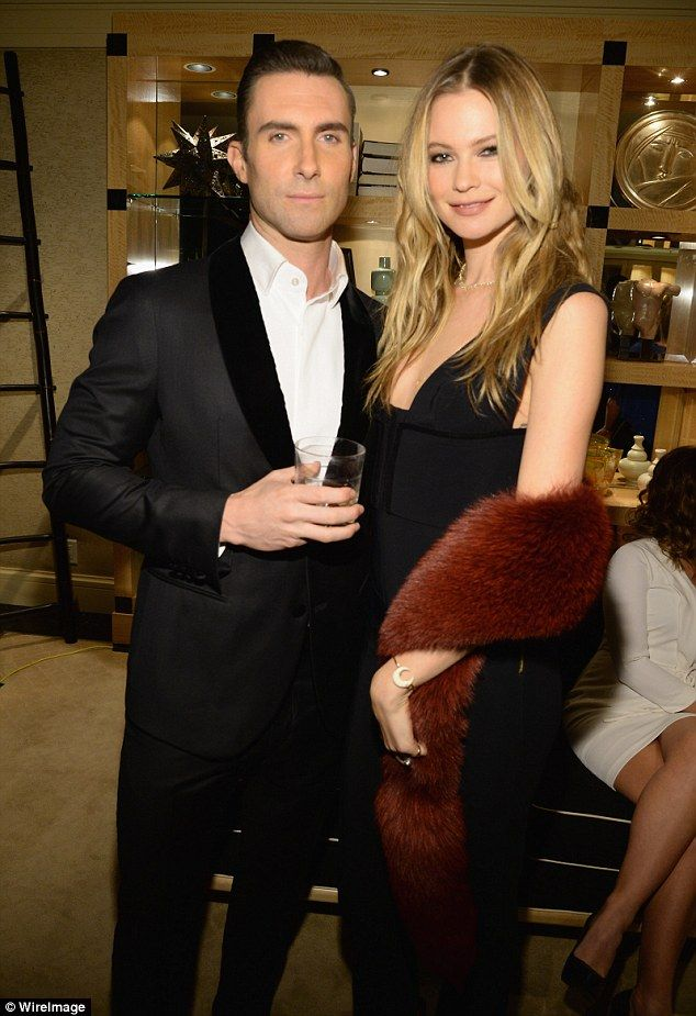 Love and marriage: Adam Levine and his supermodel wife Behati Prinsloo were all smiles