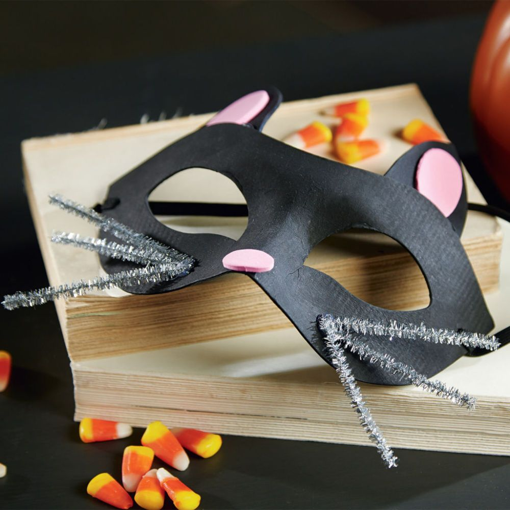 It's easy to create this adorable Kids' Cat Mask. Click through ...