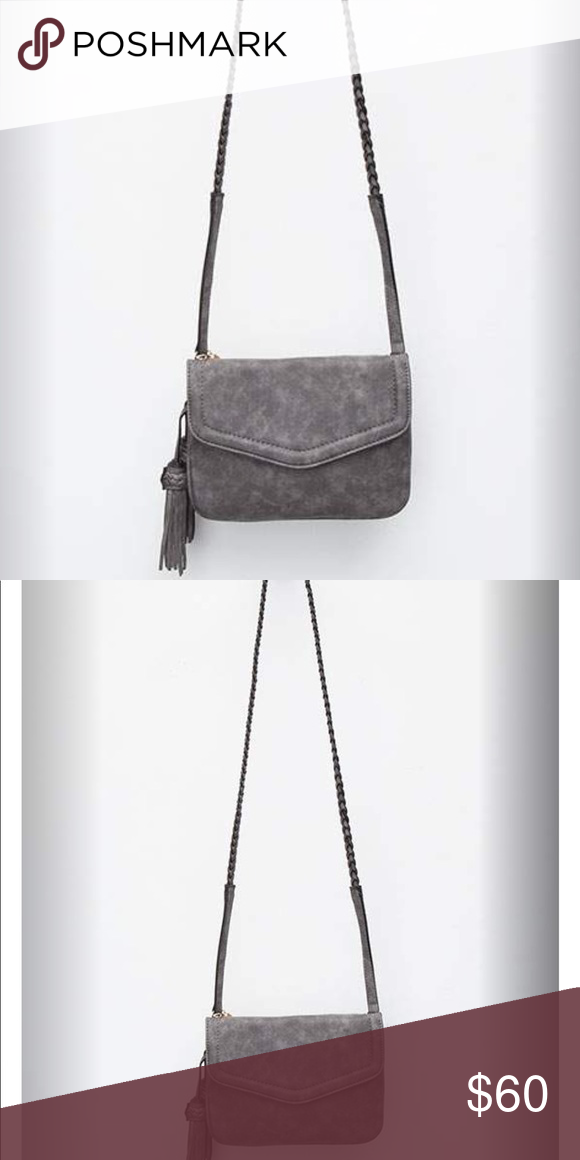 8c4f2e19d028 Annette Crossbody Bag Free People brand Violet Ray Anette faux leather crossbody  bag. This is