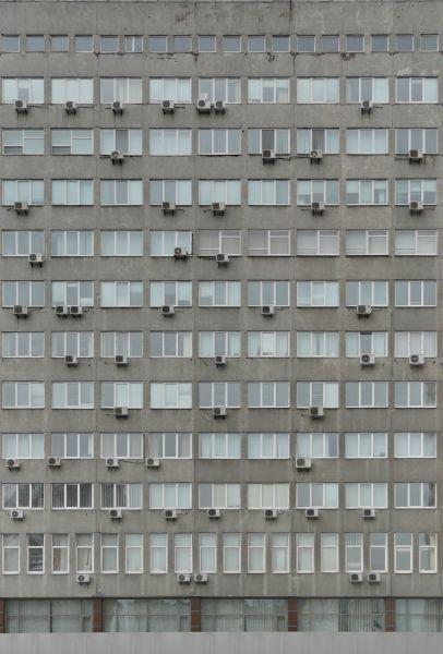 Concrete Building With Windows : Multi storey building façade of grey concrete windows and