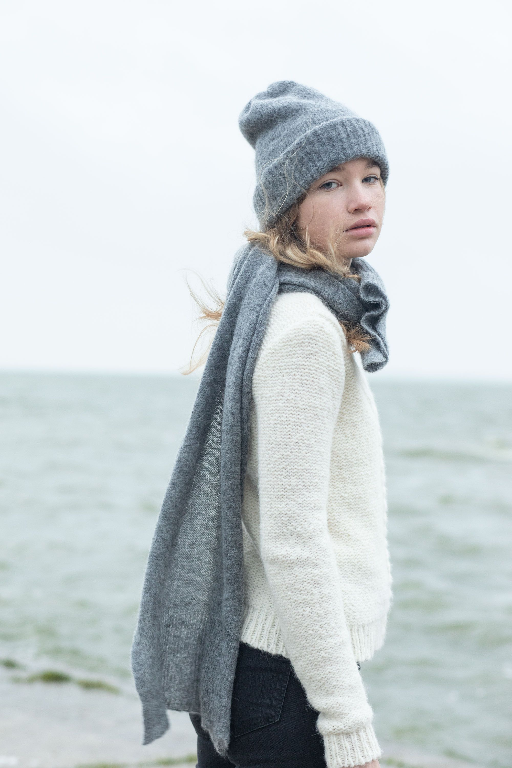 04dd80489f4 This mid-grey beanie is hand knitted from soft baby alpaca wool. It has