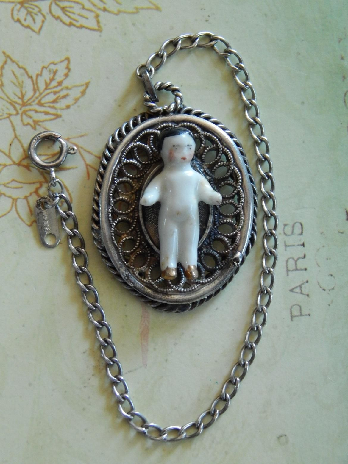 Sterling silver frozen Charlotte doll chatelaine. Now available in my Ruby Lane store: Kim's Doll Gems