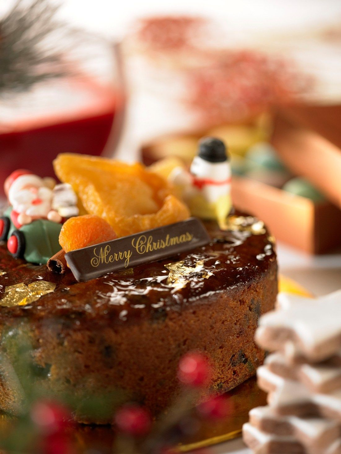 A traditional fruit cake with trimmings of the season