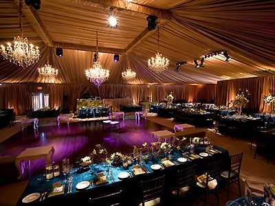 Crystal chandeliers and pin spots on the tables. Impact Lighting and Production.