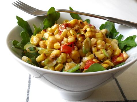 GRILLED CORN SALAD WITH SPICY CHEDDAR DRESSING. Summer time's grillin' time! Get the fire started with this spicey, healthy sidedish.