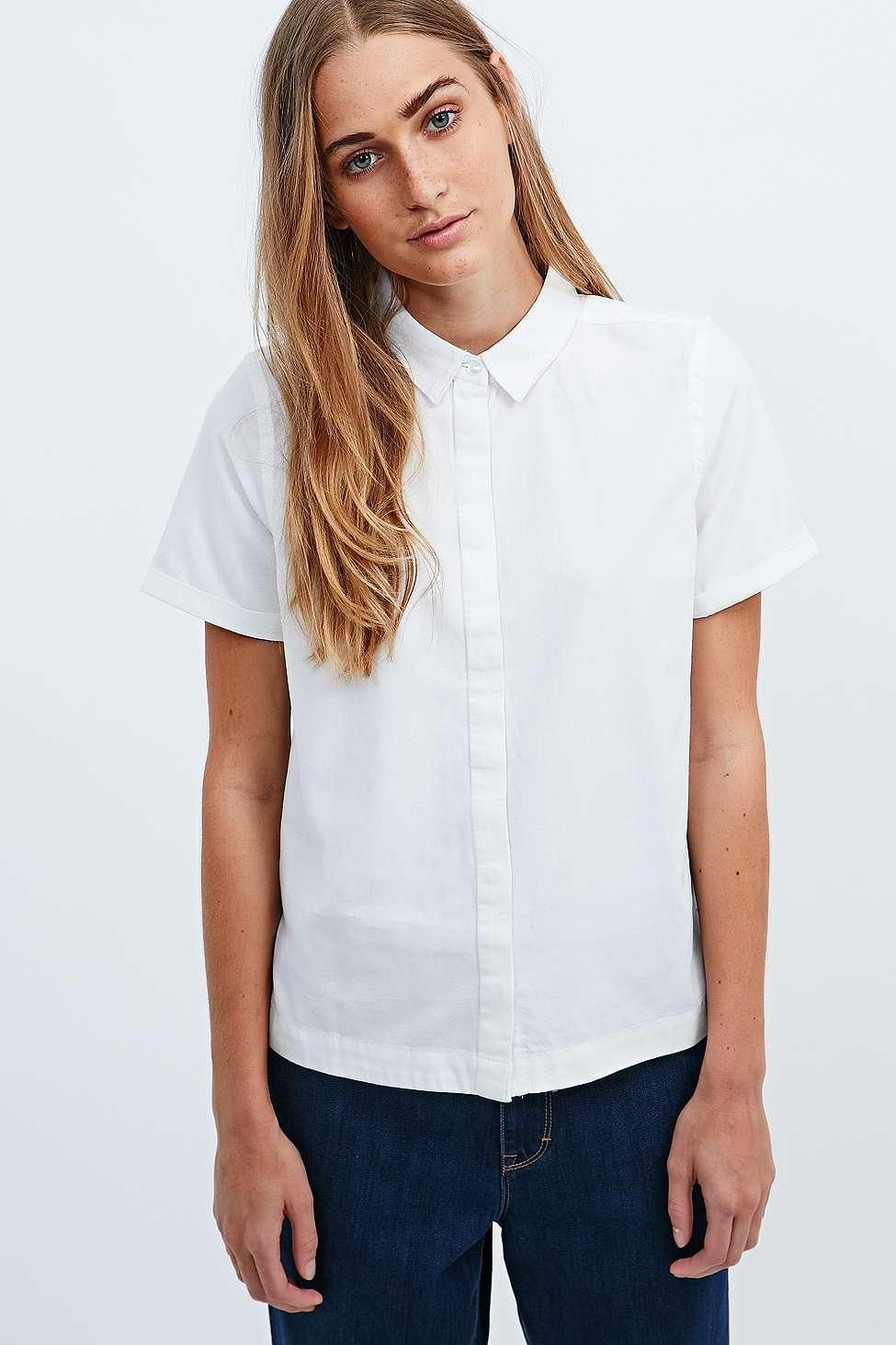 805948c1 Why You Need a Boxy, Button-Up T-Shirt - Waven Short Sleeve Oxford Shirt,  $41.60; at Urban Outfitters