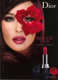Dior makeup is advertising their red lipstick. Uses a red flower around the eye to make it more fashionable.