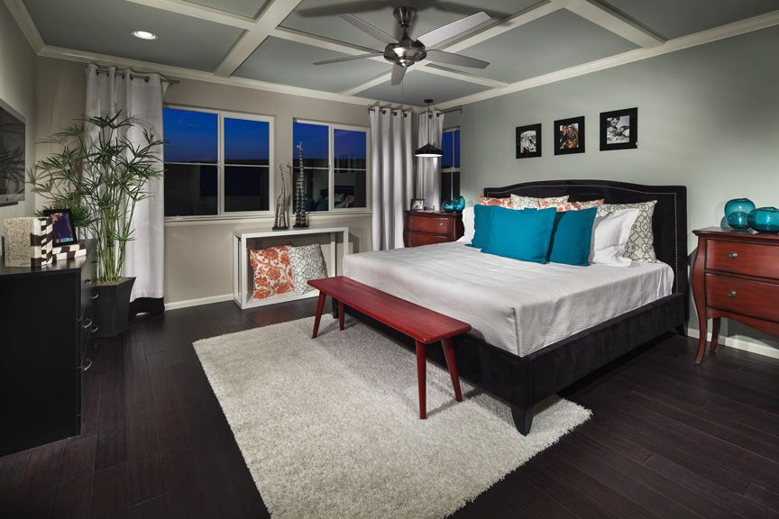 Ryland Homes U0027Collageu0027 Model At Candelas. Master Bedroom Featuring Painted  Wood Ceiling Detail, Rich Wood Floors And Pops Of Red In The Furniture.