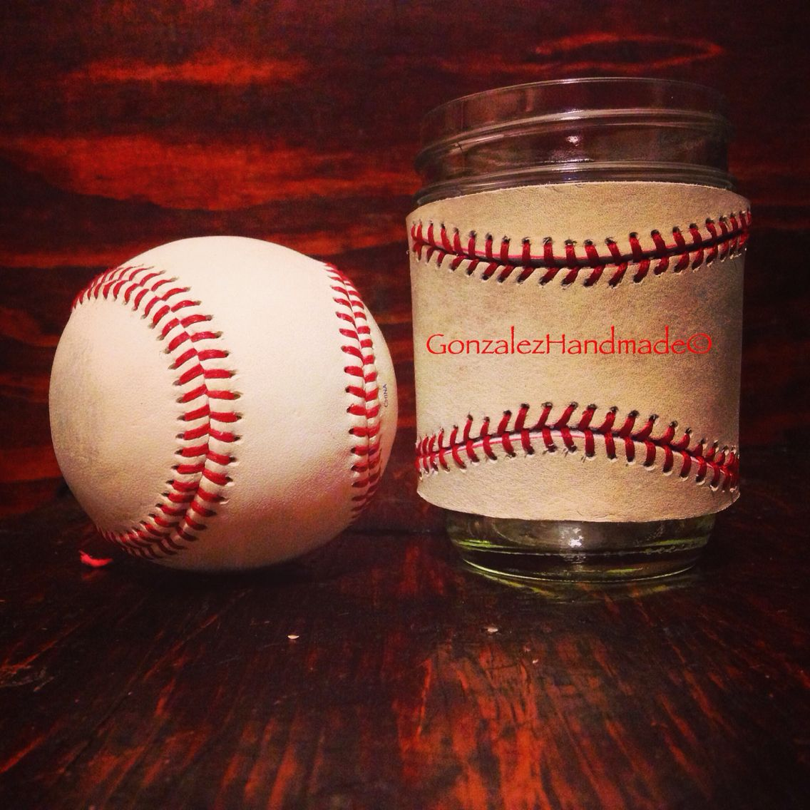 Hand made hand stitched mason jar sleeve made in a baseball theme.
