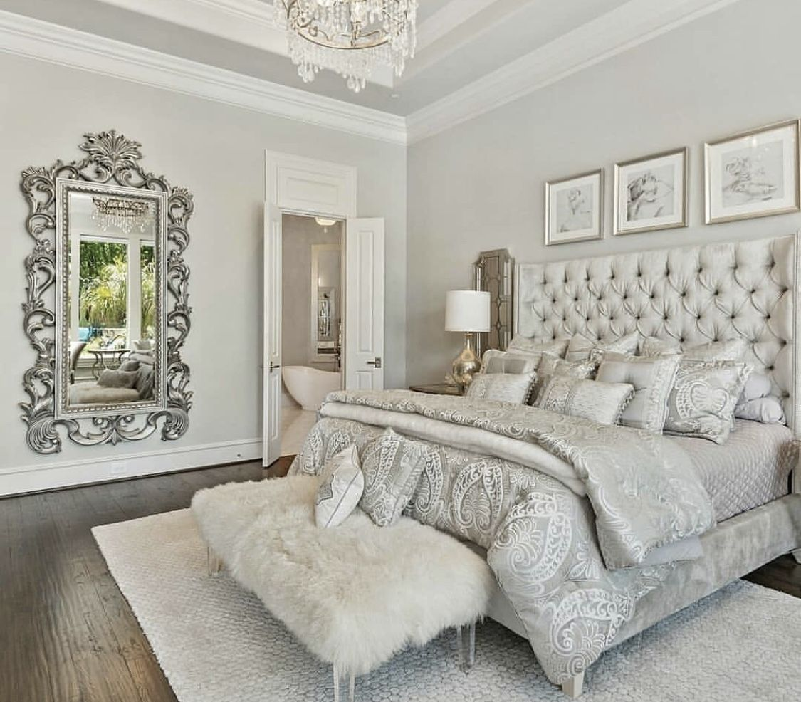 Luxury Romantic Bedroom With White Tufted Bed And Shipskin Bench