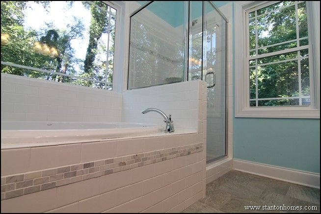 Trendy Master Bathroom - light blue walls, white subway tile, tones of grey in the tile floor and listello accents.