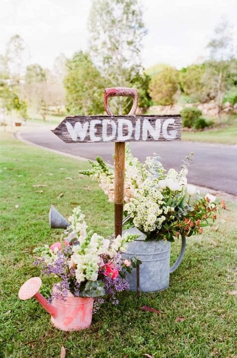 Garden Wedding Ideas intimate evening garden wedding So Cute Garden Party Wedding Sign With Watering Cans And Flowers
