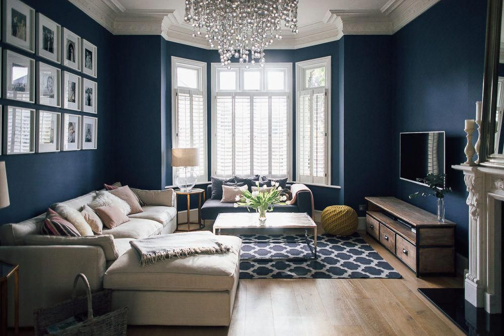 Dark Blue Sitting Room With Shutters And Glass Chandelier