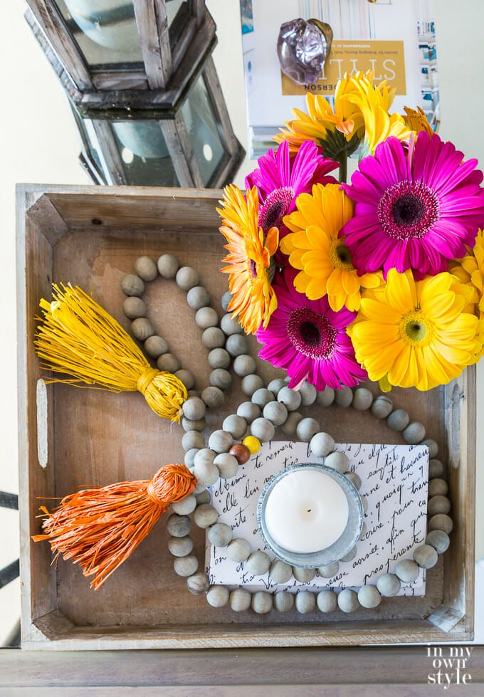 How to restyle a coffee-table tray with decorative tiles. It is a fast and easy project that allows you to decorate with trends in design without having to spend a fortune...only $8! Coffee table tray styling ideas for colorful fall decorating. #falldecor #decoratingwithtile #autumndecoratingideas #styleonabudget #coffeetablestyling