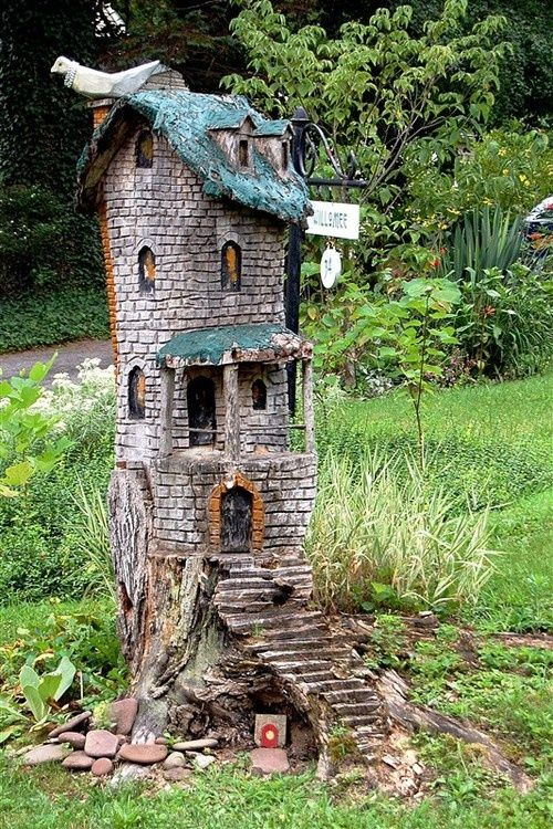 fairy condo…  neat way to camouflage a tree stump!…..i love the fantasy of fairies in the garden!!!!