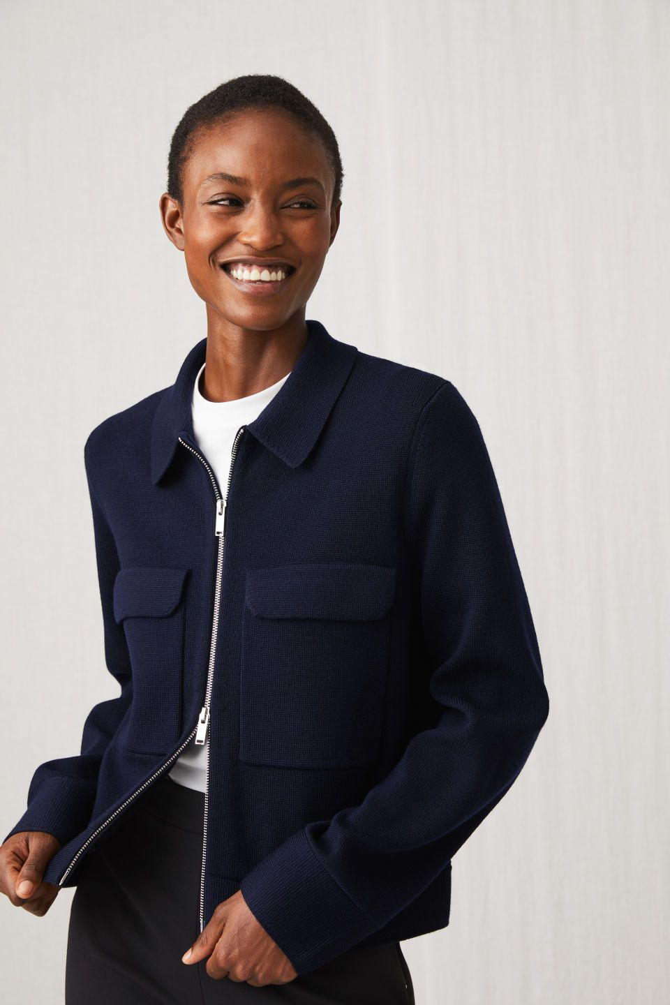 A Knitted Outerwear Garment With A Short And Boxy Shape Flat Collar Two Large Patch Pockets On The Chest And A Two Way Knitwear Women Knitwear Knit Structure