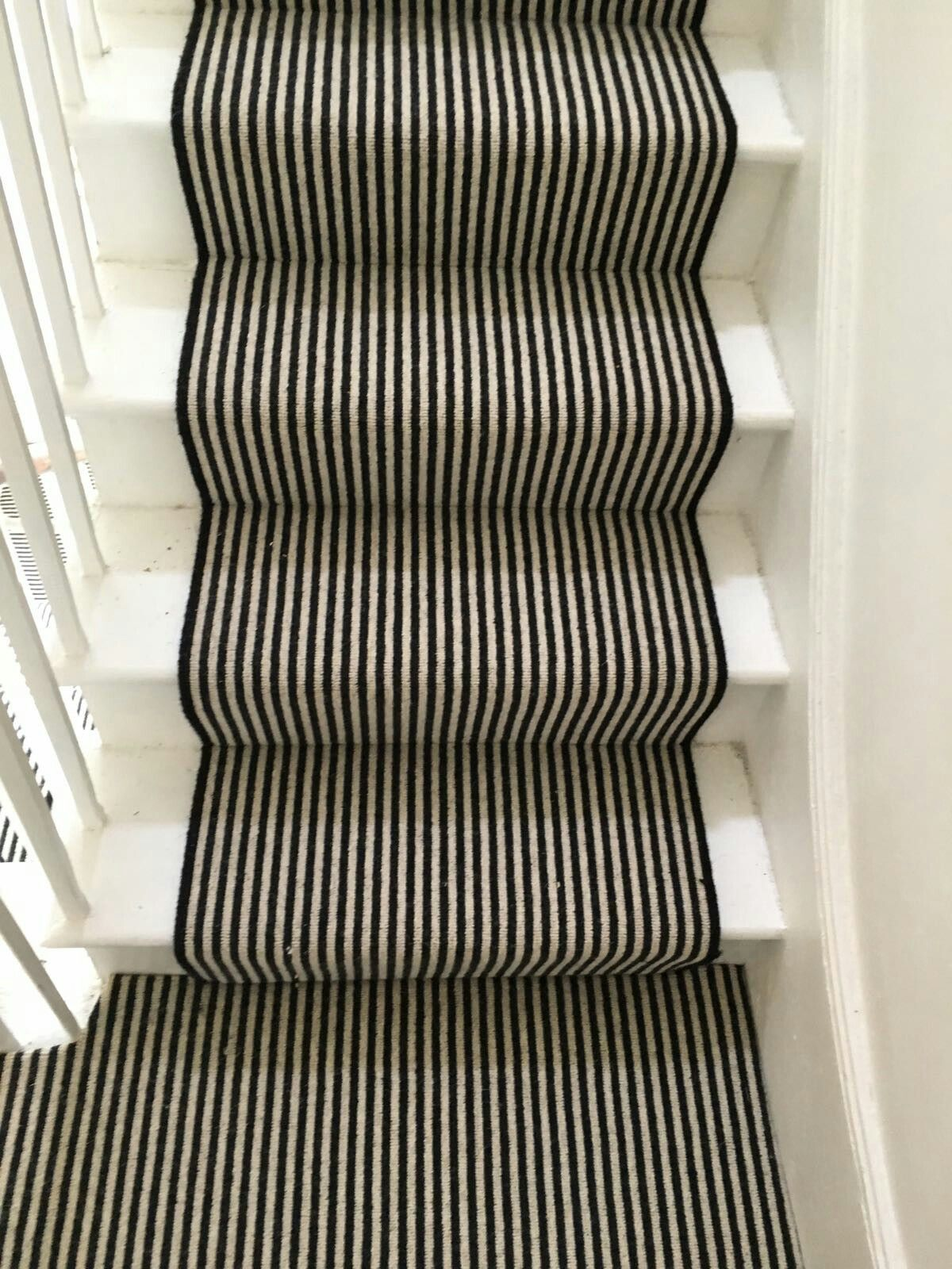Funky Black And White Stair Runner With Black Edges Fitted Onto White Wooden Stairs Carpet Stairs Stair Runner Carpet Black And White Stairs