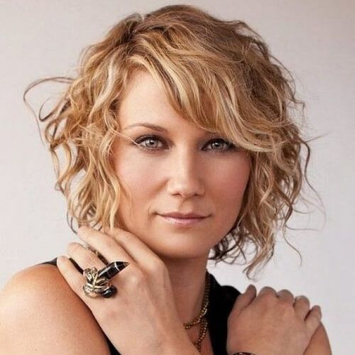 Side Swept Bangs With Short Curly Hair