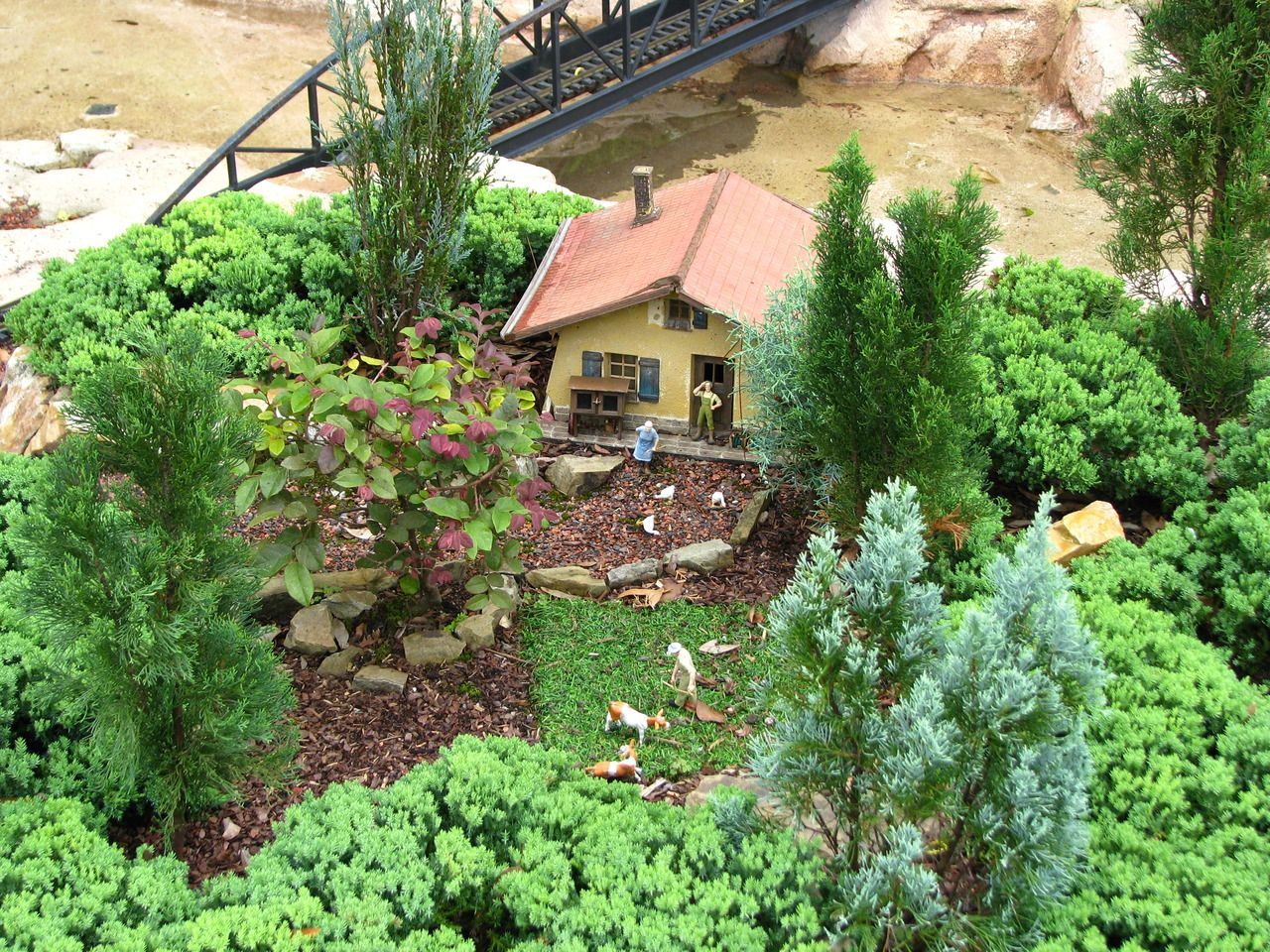 All The Small Things-So recently, I went to Walt Disney World.  The above pictures are from the Germany Pavilion in Epcot.  One of the gardens is a miniature village with several LGB trains going around.  Of course, my favorite was the little castle perched on top, looking over everything else.