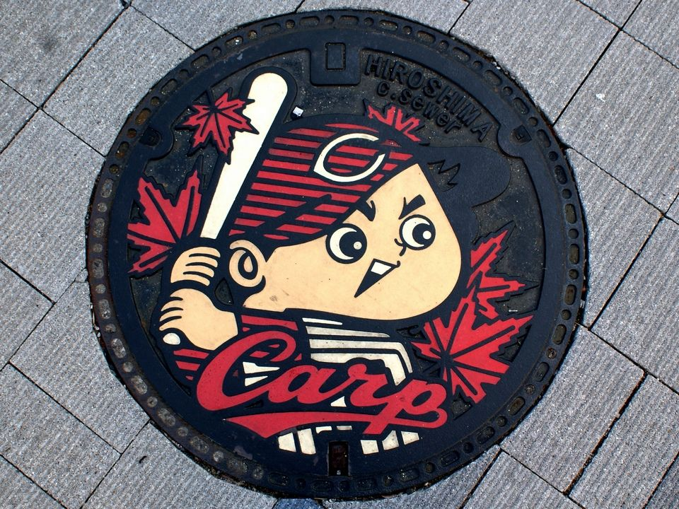 This man captures beautiful photos of manhole covers in every city he visiting in Japan