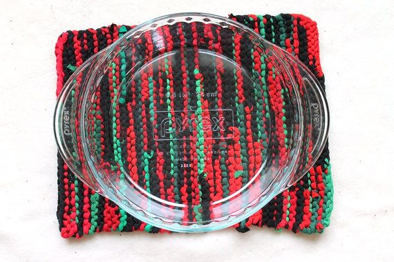 Designed for giving those Christmas pies a soft place to cool down, but suitable for other dishes as well, you will find that our pie-plate-sized trivets also make cute centerpieces.    http://www.etsy.com/listing/103721159/christmas-trivet-bright-red-green-black