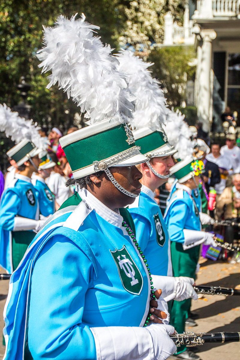 Mardi Gras costumes during New Orleans Mardi Gras. Lots of cool school bands on show. Get insider tips on how to visit Mardi Gras inside! #MardiGras #NewOrleans
