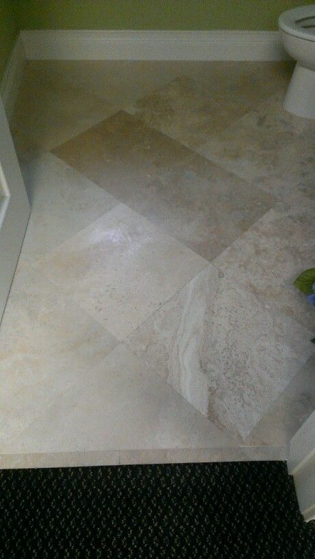 16 Inch Travertine Tile Laid On The Diagonal With No Grout Line