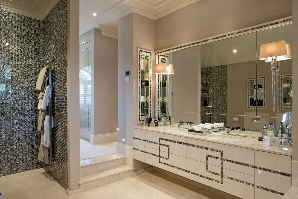 Images On Hill House Interiors chose geometric patterns to enhance the cool lines of this bathroom