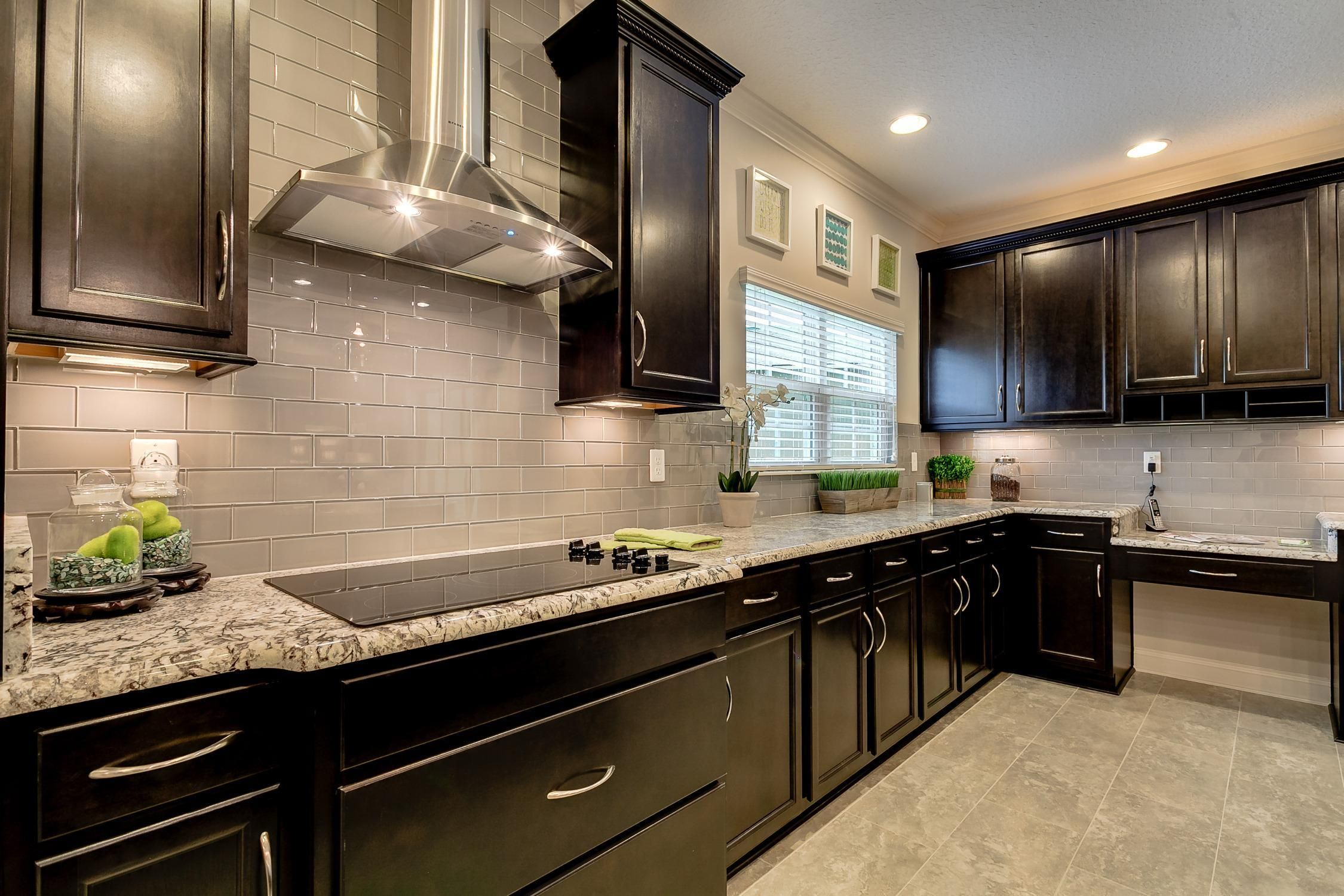 Dark wooden cabinets provide a warm aesthetic while walking into